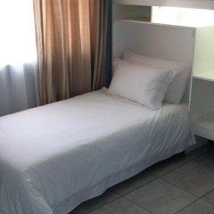 Апартаменты Gae Apartments Габороне комната для гостей фото 2