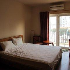 Отель Moonlight Serviced Apartmnet Хошимин комната для гостей