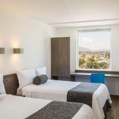 Отель One Guadalajara Expo комната для гостей фото 4