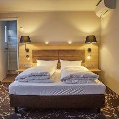 Отель Bed & Breakfast Erber Германия, Исманинг - отзывы, цены и фото номеров - забронировать отель Bed & Breakfast Erber онлайн комната для гостей фото 5