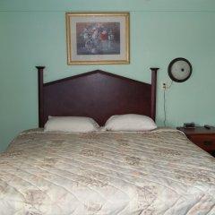 Отель Altamont Motel сейф в номере