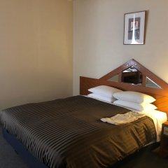 Отель Clio Court Hakata Хаката комната для гостей