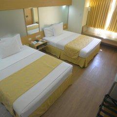 Отель Microtel Inn And Suites Davao Филиппины, Давао - отзывы, цены и фото номеров - забронировать отель Microtel Inn And Suites Davao онлайн комната для гостей фото 2