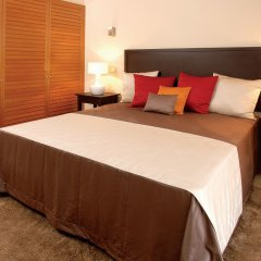 Апартаменты Amendoeira Golf Resort - Apartments and villas комната для гостей фото 3