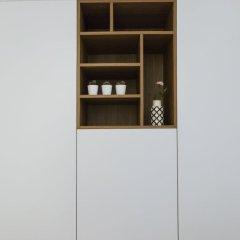Апартаменты Homewell Apartments Wilson Park сейф в номере