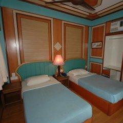 Отель Shari-La Island Resort комната для гостей