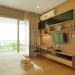 Отель Reflection Jomtien Beach Condo By Dome Паттайя комната для гостей
