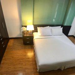 Отель Twin Peaks Sukhumvit Suites Бангкок комната для гостей фото 2