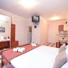Отель Апарт-Отель D&D Apartments Tivat Черногория, Тиват - 4 отзыва об отеле, цены и фото номеров - забронировать отель Апарт-Отель D&D Apartments Tivat онлайн комната для гостей фото 2