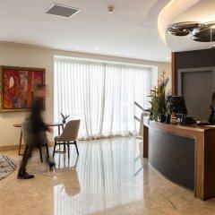 Отель Pestana Porto- A Brasileira City Center & Heritage Building интерьер отеля