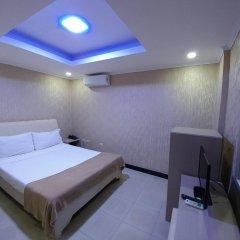 Отель OYO 700 Pj Inn Hotel Филиппины, Пампанга - отзывы, цены и фото номеров - забронировать отель OYO 700 Pj Inn Hotel онлайн комната для гостей