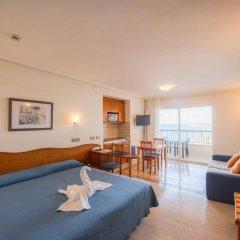 Отель Apartamentos Blau Parc Испания, Сан-Антони-де-Портмань - 1 отзыв об отеле, цены и фото номеров - забронировать отель Apartamentos Blau Parc онлайн комната для гостей фото 2