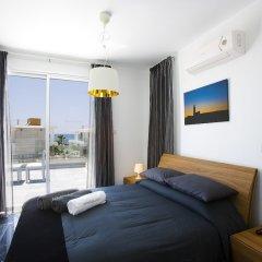 Отель Paradise Cove Luxurious Beach Villas Кипр, Пафос - отзывы, цены и фото номеров - забронировать отель Paradise Cove Luxurious Beach Villas онлайн комната для гостей фото 17