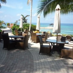 Отель Palmyra Luxury Beach Condo пляж