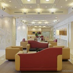 Отель Holiday Inn Athens Attica Av. Airport West интерьер отеля