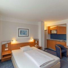 Отель Ramada by Wyndham Hannover Германия, Ганновер - отзывы, цены и фото номеров - забронировать отель Ramada by Wyndham Hannover онлайн комната для гостей фото 5
