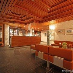 Отель Hauser Swiss Quality Hotel Швейцария, Санкт-Мориц - отзывы, цены и фото номеров - забронировать отель Hauser Swiss Quality Hotel онлайн гостиничный бар