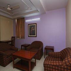 OYO 645 Hotel Tourist Deluxe комната для гостей