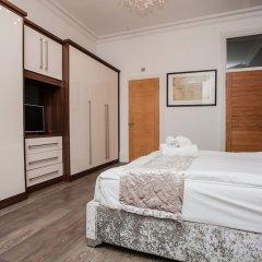 Отель Beautiful 4 Bedroom House in South Kensington комната для гостей фото 2