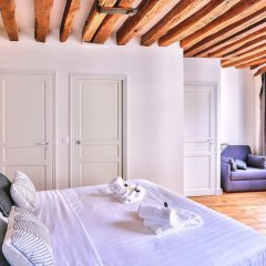 Апартаменты Amazing Apartment Close to Notre Dame Париж комната для гостей фото 3