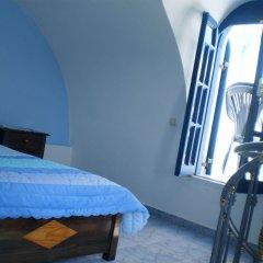 Отель Roula Villa Греция, Остров Санторини - отзывы, цены и фото номеров - забронировать отель Roula Villa онлайн комната для гостей фото 2