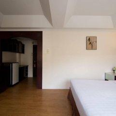 Отель LK Mansion сейф в номере