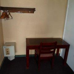 Отель Heritage Inn сейф в номере