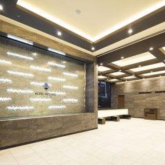 Отель MYSTAYS PREMIER Akasaka Япония, Токио - отзывы, цены и фото номеров - забронировать отель MYSTAYS PREMIER Akasaka онлайн интерьер отеля фото 2