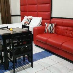 Отель Luxury Suites E Филиппины, Пампанга - отзывы, цены и фото номеров - забронировать отель Luxury Suites E онлайн комната для гостей фото 3