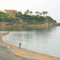 Отель Blue Coral Beach Villas пляж фото 2