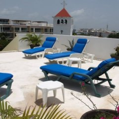 Отель El Campanario Studios & Suites Мексика, Плая-дель-Кармен - отзывы, цены и фото номеров - забронировать отель El Campanario Studios & Suites онлайн с домашними животными