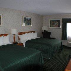 Отель All Seasons Inn and Suites комната для гостей фото 2