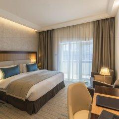 Отель Golden Tulip Al Thanyah комната для гостей фото 4