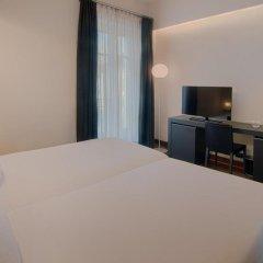 Отель NH Torino Santo Stefano Италия, Турин - 1 отзыв об отеле, цены и фото номеров - забронировать отель NH Torino Santo Stefano онлайн удобства в номере фото 2