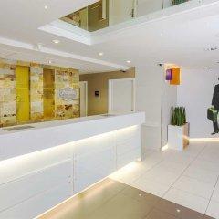 Отель Hampton by Hilton Liverpool/John Lennon Airport Великобритания, Ливерпуль - отзывы, цены и фото номеров - забронировать отель Hampton by Hilton Liverpool/John Lennon Airport онлайн интерьер отеля