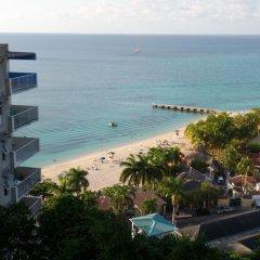 Отель Sundown Beach Studio At Montego Bay Club Ямайка, Монтего-Бей - отзывы, цены и фото номеров - забронировать отель Sundown Beach Studio At Montego Bay Club онлайн пляж