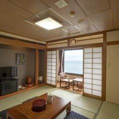 Отель Seaside Hotel Yakushima Япония, Якусима - отзывы, цены и фото номеров - забронировать отель Seaside Hotel Yakushima онлайн комната для гостей фото 4