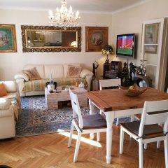 Апартаменты Villa DaVinci - Garden Apartment Вербания комната для гостей фото 4