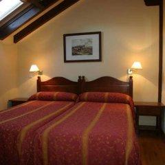 Отель Apartamentos Villa De Potes Потес сейф в номере