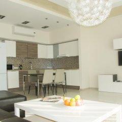 Апартаменты ApartSochi Сочи комната для гостей фото 5