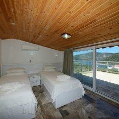 Отель Villa Mercan 1 by Akdenizvillam Калкан комната для гостей фото 5