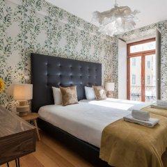 Апартаменты Chiado Modern Three-Bedroom Apartment - by LU Holidays комната для гостей фото 2