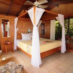 Отель Coconut Grove Beachfront Cottages комната для гостей фото 3