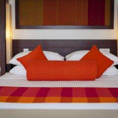 Отель The Calm Resort & Spa сейф в номере