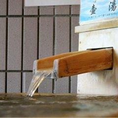 Отель Kyukamura Minami-Aso National Park Resort Villages Of Japan Минамиогуни сейф в номере