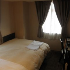 Отель Hospitality In Yawatajuku Камагая комната для гостей фото 2