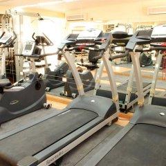 Отель Al Liwan Suites фитнесс-зал фото 2
