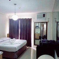 Отель Green Suites at Bel Air Soho Филиппины, Макати - отзывы, цены и фото номеров - забронировать отель Green Suites at Bel Air Soho онлайн комната для гостей