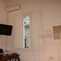 Отель Corto Maltese Guest House удобства в номере