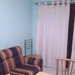 Апартаменты Farfett Apartments Меллиха удобства в номере